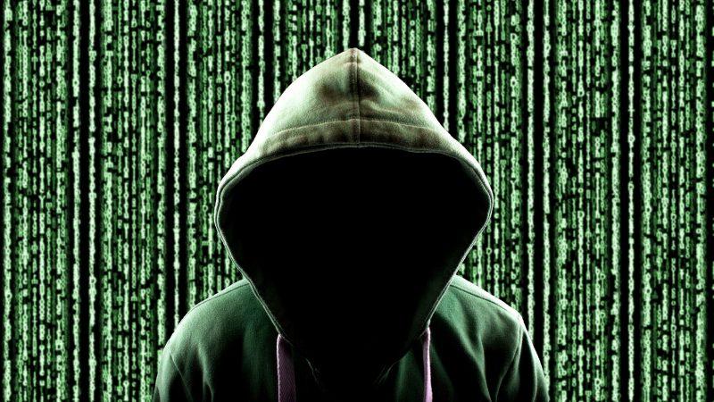 cyber attacker in hoodie